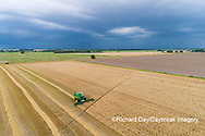 63801-14313 Aerial view of combine harvesting wheat ahead of a thunderstorm Marion Co. IL