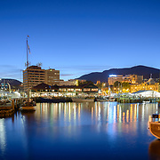Hobart waterfront at night with Mount Wellington in background
