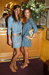 Left to right, ZARA SIMON and JESSICA SIMON daughters of Peter Simon at a private dinner and presentation of Issa's Autumn-Winter 2005-2006 collection held at Annabel's, 44 Berkeley Square, London on 15th March 2005.<br /><br />NON EXCLUSIVE - WORLD RIGHTS