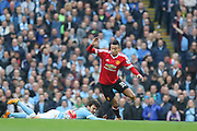 Jesse Lingard of Manchester United leaves Manchester City midfielder David Silva (21) on the floor during the Barclays Premier League match between Manchester City and Manchester United at the Etihad Stadium, Manchester, England on 20 March 2016. Photo by Phil Duncan.