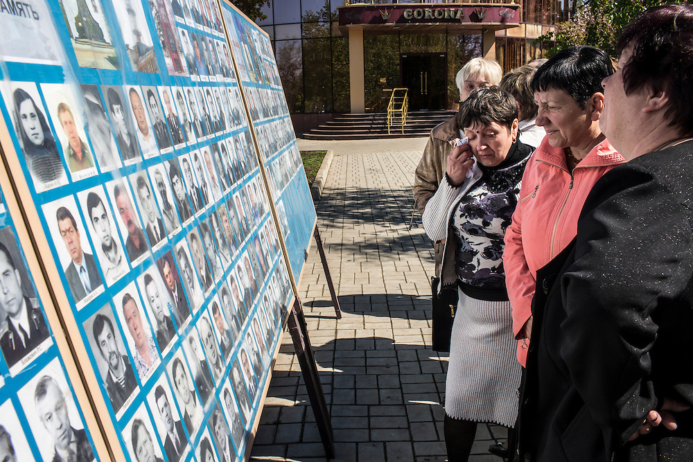 DONETSK, UKRAINE - APRIL 25:  People look at photographs of victims of the 1986 Chernobyl nuclear accident following a memorial service to commemorate the annivesary on April 25, 2014 in Donetsk, Ukraine. The accident, which took place in the northern part of Ukraine, is considered the worst nuclear accident in history. (Photo by Brendan Hoffman/Getty Images) *** Local Caption ***