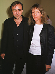 MR NICK READING and MISS SABRINA GUINNESS  at a party in London on 17th June 1999.MTK 66
