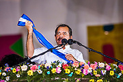 "10 JANUARY 2007 - MANAGUA, NICARAGUA:  DANIEL ORTEGA, President of Nicaragua, holds up the Presidential sash during his inaugural speech in Managua Wednesday night. Ortega, the leader of the Sandanista Front, was sworn in as the President of Nicaragua Wednesday. Ortega and the Sandanistas ruled Nicaragua from their victory of ""Tacho"" Somoza in 1979 until their defeat by Violetta Chamorro in the 1990 election.  Photo by Jack Kurtz"