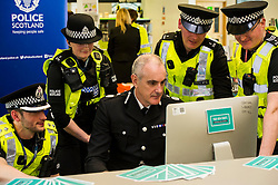 Pictured: Inspec tor Alan Carson, PC Louise Gordon, PC Martin Wood and Sargent Kevin Smith watched as Phil, Gormley completed the survey<br /> Police Scotland Chief Constable Phil Gormley unveiled details of the 'Your View Counts' exercise, which will help shape policing priorities throughout the country in Edinburgh today. <br /> Ger Harley | EEm 7 April 2016