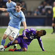 Thomas McNamara, (left), NYCFC, is tackled by Cristian Higuita , Orlando, during the New York City FC Vs Orlando City, MSL regular season football match at Yankee Stadium, The Bronx, New York,  USA. 18th March 2016. Photo Tim Clayton
