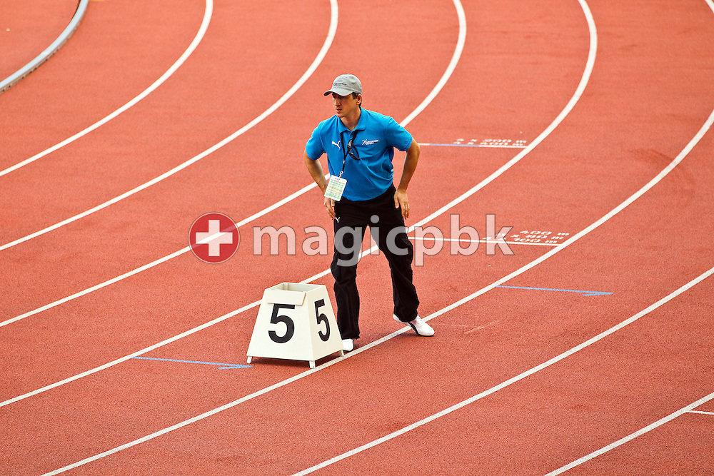 A volunteer places a number sing on the track prior to the IAAF Diamond League meeting at the Letzigrund Stadium in Zurich, Switzerland, Thursday, Aug. 19, 2010. (Photo by Patrick B. Kraemer / MAGICPBK)