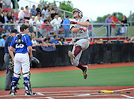 Holy Cross Tim Petrucelli #24 leaps in the air celebrating as he scores the game tying run against Gill St. Bernard's in the sixth inning of the NJSIAA South Jersey Non-Public B championship baseball game Tuesday June 7, 2016 at Rutgers University in Piscataway, New Jersey. Holy Cross defeated Gill St. Bernard's 4-3. (Photo by William Thomas Cain)