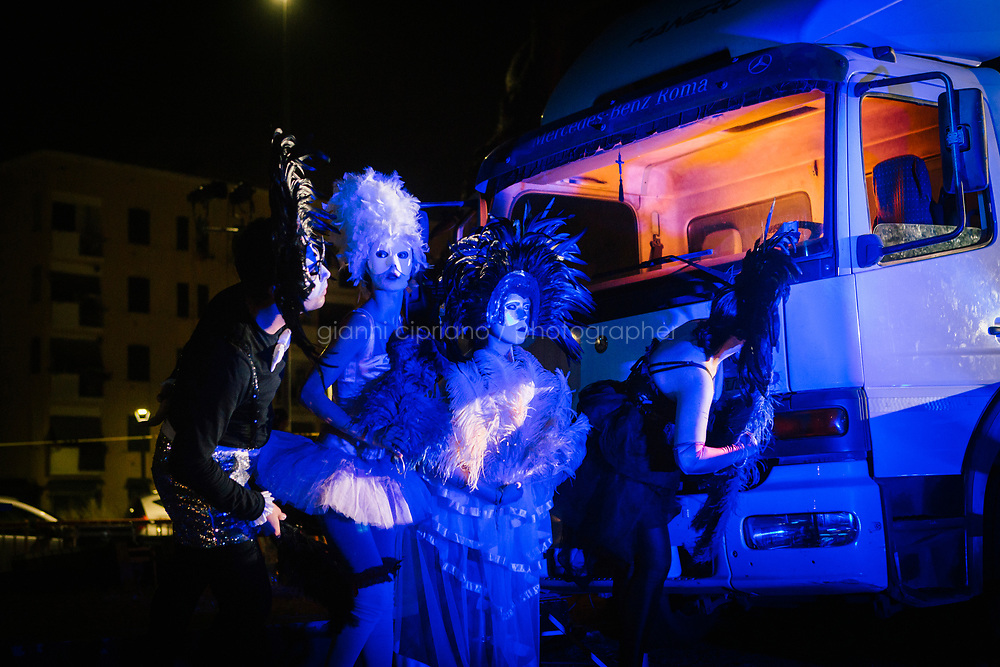 ROME, ITALY - 27 JUNE 2017: Opera actors are seen here before walking up on stage to perform for the &quot;Don Giovanni OperaCamion&quot;, an open-air opera performed on a truck in San Basilio, a suburb in Rome, Italy, on June 27th 2017.<br /> <br /> Director Fabio Cherstich&rsquo;s idae of an &ldquo;opera truck&rdquo; was conceived as a way of bringing the musical theatre to a new, mixed, non elitist public, and have it perceived as a moment of cultural sharing, intelligent entertainment and no longer as an inaccessible and costly event. The truck becomes a stage that goes from square to square with its orchestra and its company of singers in Rome. <br /> <br /> &ldquo;Don Giovanni Opera Camion&rdquo;, after &ldquo;Don Giovanni&rdquo; by Wolfgang Amadeus Mozart is a new production by the Teatro dell&rsquo;Opera di Roma, conceived and directed by Fabio Cherstich. Set, videos and costumes by Gianluigi Toccafondo. The Youth Orchestra of the Teatro dell&rsquo;Opera di Roma is conducted by Carlo Donadio.