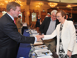 An Taoiseach Enda KennyTD greeting the Attorney General Máire Whelan SC on his attendance at the  Bar of Ireland Conference in Westport.<br /> Pic Conor McKeown