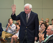 Former Texas governor Mark White acknowledges the crowd after Houston ISD trustees voted to name a new school in his honor during a Board of Education meeting, June 12, 2014.