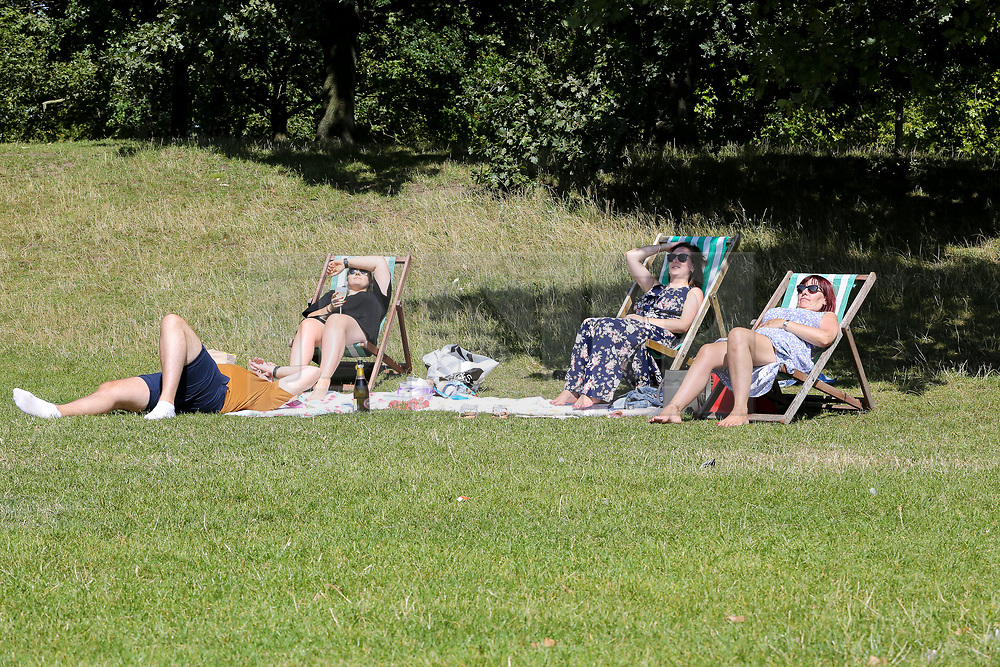 © Licensed to London News Pictures. 22/08/2019. London, UK. Lauren, Tom, Emily and Karen (L to R) enjoys the warm and sunny weather in London's Hyde Park. According to the Met Office, the temperatures are forecast to increase to 30 degrees celsius over the bank holiday weekend. <br /> <br /> ***Permission Granted***<br /> <br /> Photo credit: Dinendra Haria/LNP