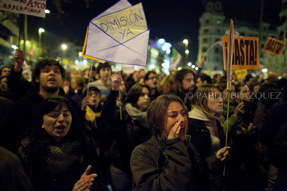 Protesters shout slogans during demonstration against political corruption and claiming Mariano Rajoy to resign outside the PP headquarters in Madrid on January 31, 2013. The Spanish Newspaper 'El Pais' published secret papers of income implicating Spanish Prime Minister and other members of the PP (Popular Party). Rajoy's government has denied these secret payments.