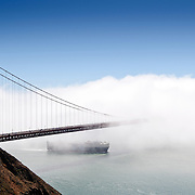 San Francisco's Golden Gate Bridge obscured by dense fog taken from Golden Gate Recreational Park