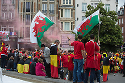 LILLE, FRANCE - Friday, July 1, 2016: Wales fans wave flags in the centre of Lille ahead of the UEFA Euro 2016 Championship Quarter-Final match against Belgium at the Stade Pierre Mauroy. (Pic by Paul Greenwood/Propaganda)