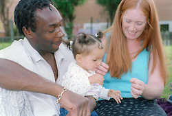 Couple playing with their baby daughter,