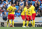 Watford Troy Deeney celebrates the opening goal during the Sky Bet Championship match between Brighton and Hove Albion and Watford at the American Express Community Stadium, Brighton and Hove, England on 25 April 2015. Photo by Phil Duncan.