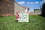 A sign on an empty plot of land remembers a person named Don who died over 11 years ago. Detroit, USA, 2011
