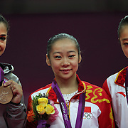 Alexandra Raisman, USA, with her Bronze Medal (left) Linlin Deng, China, Gold, and Lu Sui. Silver (right)  in the Women's Gymnastics Apparatus Beam final at North Greenwich Arena during the London 2012 Olympic games London, UK. 7th August 2012. Photo Tim Clayton