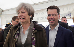 © Licensed to London News Pictures. 13/05/2017. Lisburn, UK. British prime minister THERESA MAY during a visit to Balmoral Show at Balmoral Park in Lisburn, Northern Ireland, with Secretary of State for Northern Ireland JAMES BROKENSHIRE, while campaigning ahead of a general election which takes place on June 8, 2017.  Photo credit: Kalista McErlane/LNP