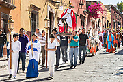 Believers carry a statue of Jesus during a Palm Sunday procession through the streets at the start of Holy Week March 25, 2018 in San Miguel de Allende, Mexico. Christians commemorate the entry of Jesus into Jerusalem when it was believed that the citizens laid down palm branches in his path.