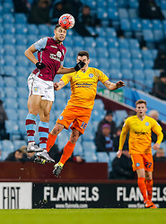 Rudy Gestede of Aston Villa and Matthew Bloomfield of Wycombe Wanderers compete in the air - Mandatory byline: Rogan Thomson/JMP - 19/01/2016 - FOOTBALL - Villa Park Stadium - Birmingham, England - Aston Villa v Wycombe Wanderers - FA Cup Third Round Replay.