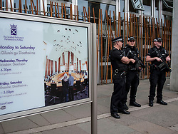 Armed police stand guard at the Scottish Parliament in Edinburgh in the wake of the Manchester Arena bombing and the decision by the Prime Minister to activate Operation Temperer.<br /> <br /> &copy; Dave Johnston/ EEm