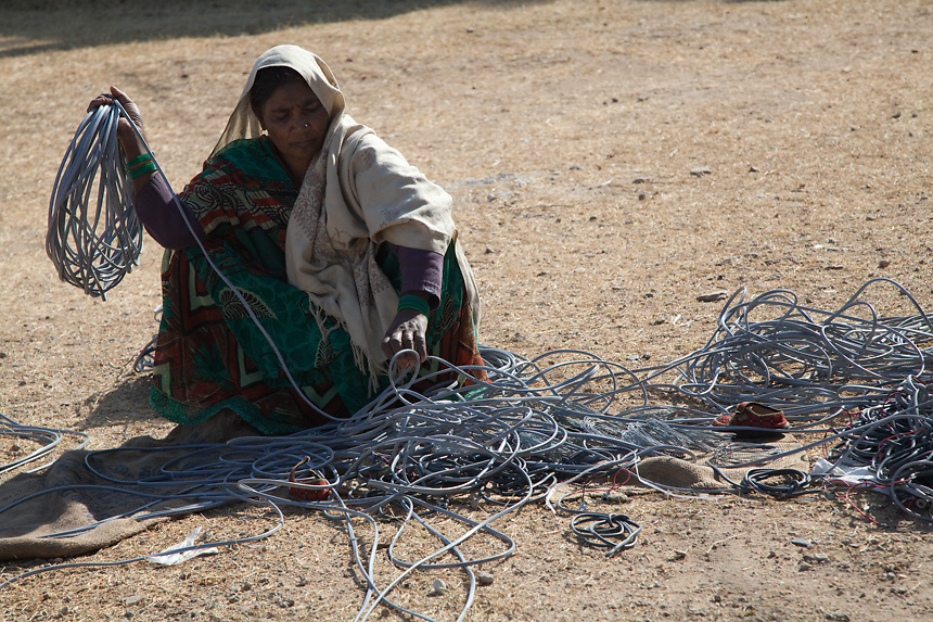 A woman rolling up electric cables in Barefoot College old campus - In Rajasthan solar energy is today a solutions in four critical areas of village life:  solar electrification of more than 1000 villages, hot water, solar cookers, and fresh drinking water through solar powered desalination. 01/2013 © Marida Augusto/Max Hirzel