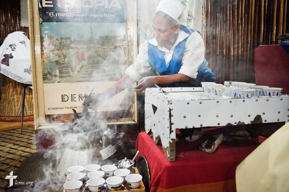 A woman prepares a traditional Ethiopian coffee ceremony with incense at a restaurant in Addis Ababa, Ethiopia, on Sunday, Nov. 9, 2014. LCMS Communications/Erik M. Lunsford