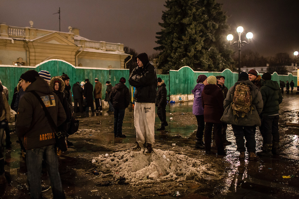 KIEV, UKRAINE - DECEMBER 12: A man stands on a small pile of snow after a rally held by the pro-government Party of Regions in support of Ukrainian President Viktor Yanukovych on December 12, 2013 in Kiev, Ukraine. Thousands of people have been protesting against the government since a decision by President Yanukovych to suspend a trade and partnership agreement with the European Union in favor of incentives from Russia. (Photo by Brendan Hoffman/Getty Images) *** Local Caption ***