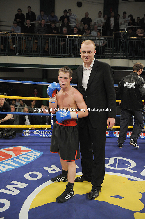 Charlie Hoy and Manager Mickey Helliett after defeating Delroy Spencer in a 4x3 min Flyweight contest at York Hall, Bethnal Green, London on Friday 13th January 2012. Queensbury Promotions © Leigh Dawney 2012