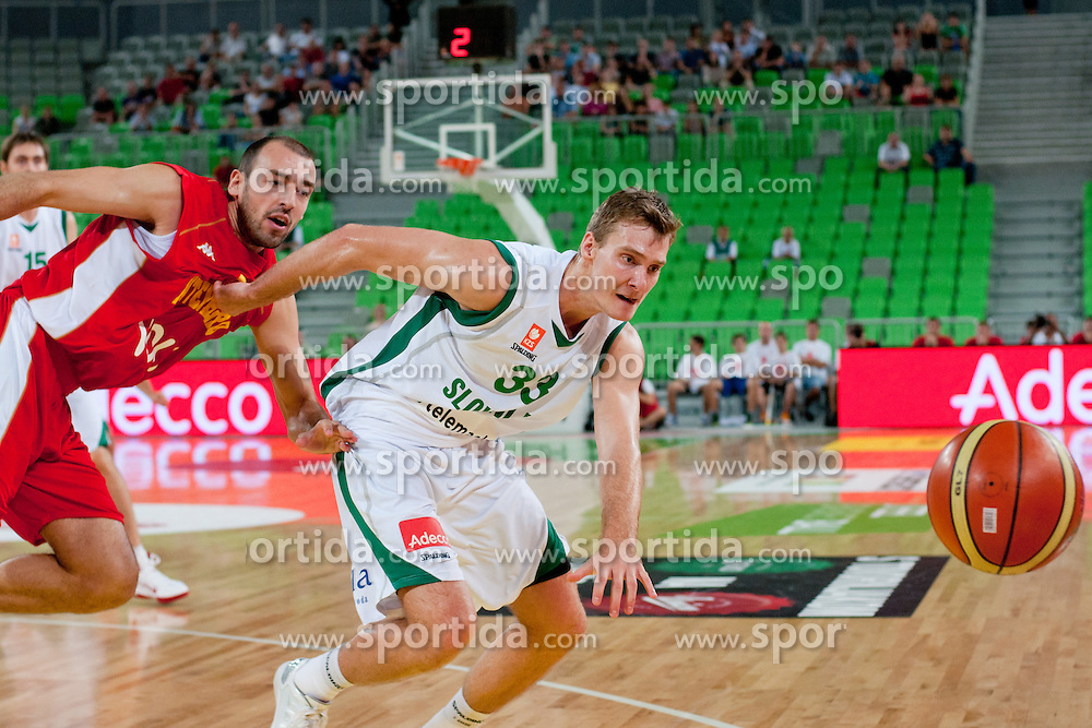 Zoran Dragic of Slovenia and Milos Borisov of Montenegro chasing the ball at friendly match between Slovenia and Montenegro for Adecco Cup 2011 as part of exhibition games before European Championship Lithuania on August 7, 2011, in SRC Stozice, Ljubljana, Slovenia. (Photo by Matic Klansek Velej / Sportida)