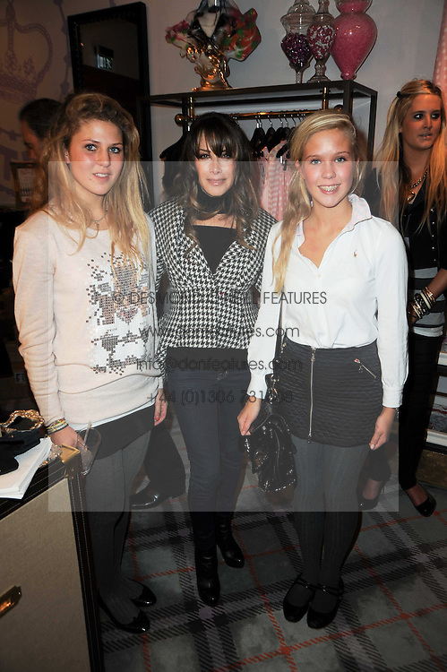 Left to right, GEORGIA HERD, GELA NASH-TAYLOR and ELLIE HERD at the Juicy Couture children's tea party in aid of Mothers 4 Children held at the Juicy Couture Store, Bruton Street, London on2nd December 2009.