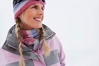 Woman standing on ski slope portrait