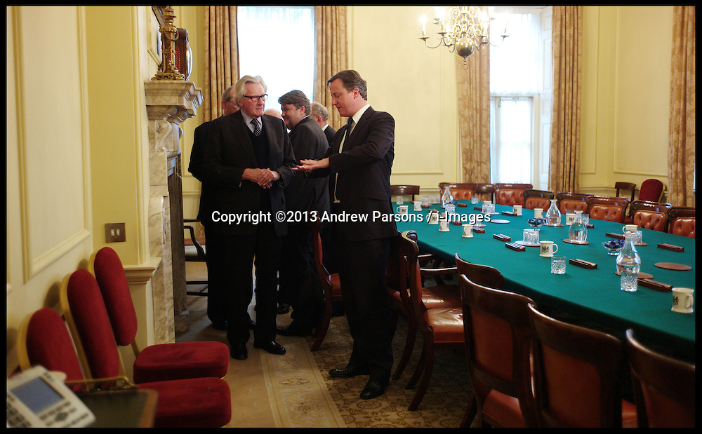 The Prime Minister David Cameron talks to Lord Heseltine in the Cabinet room after a former cabinet members meeting, Tuesday December 6, 2011. Photo By Andrew Parsons/ i-Images