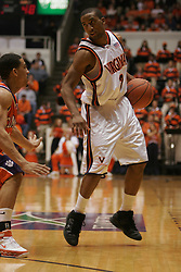 J. R. Reynolds (2) stares down a Clemson defender.  Reynolds had 10 points to help the Cavs to a 64-58 ACC victory.