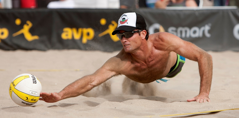 Huntington Beach, CA - October 19th, 2013. Matt Olsen playing with partner Matt Prosser, dives for a ball in the sand against opponents BillyAllan/Brady Halverson, in the last AVP professional beach volleyball tournament of the year. Allen/Halverson won 21-15, 24-22. Photo by Wally Nell/DIG Magazine.