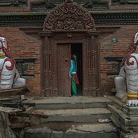a local woman entering in a collapsed temple in Kathmandu, Nepal 27 april 2015 following the devastating 7.9 magnitude earthquake that hit the country 25 April 2015.