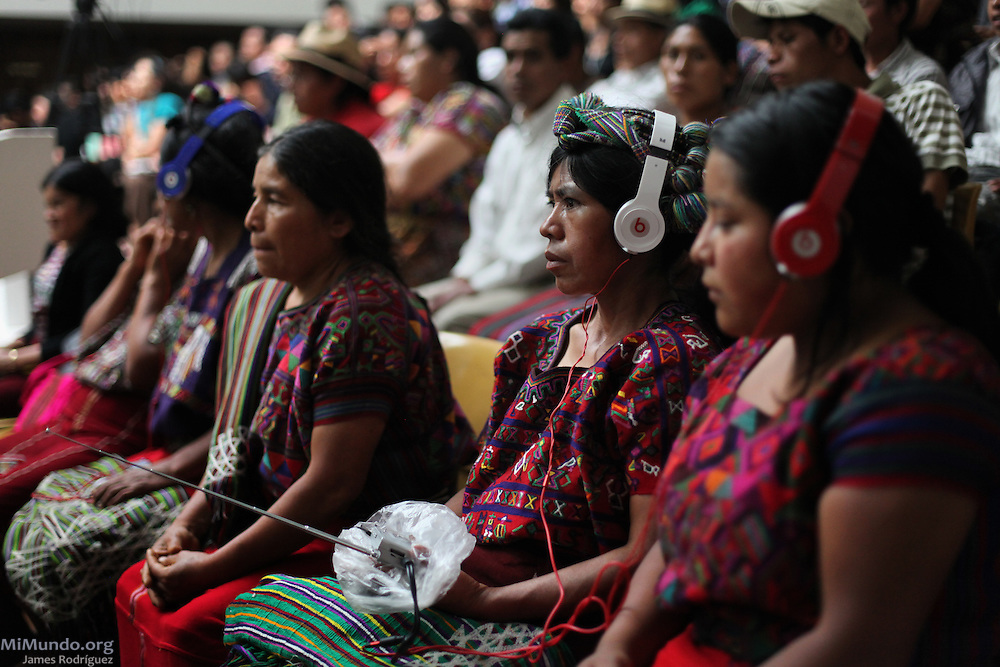 Ixil Mayan women listen to Spanish-Ixil translation in the courtroom during the twentieth day of the historic genocide trial against former de facto dictator Efrain Rios Montt and his head of Intelligence Jose Mauricio Rodriguez Sanchez. Both are accused of genocide and crimes against humanity committed against the Ixil Mayan people during their de facto reign from March 1982 to August 1983. Guatemala, Guatemala. April 18, 2013.
