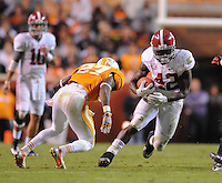 Oct 20, 2012; Knoxville, TN, USA;  Tennessee Volunteers defensive back Justin Coleman (27) tries to tackle Alabama Crimson Tide running back Eddie Lacy (42) during the second half at Neyland Stadium. Alabama won by a score of 44 to 13. Mandatory Credit: Randy Sartin-US PRESSWIRE