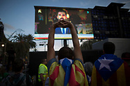 Spain, Barcelona: Pro-independence supporters take part in a rally in Barcelona, Spain, Tuesday, Oct. 10, 2017.Catalan President Puigdemont has proposed to suspend Catalonia's declaration of independence for few weeks to hold talks with Spanish government.