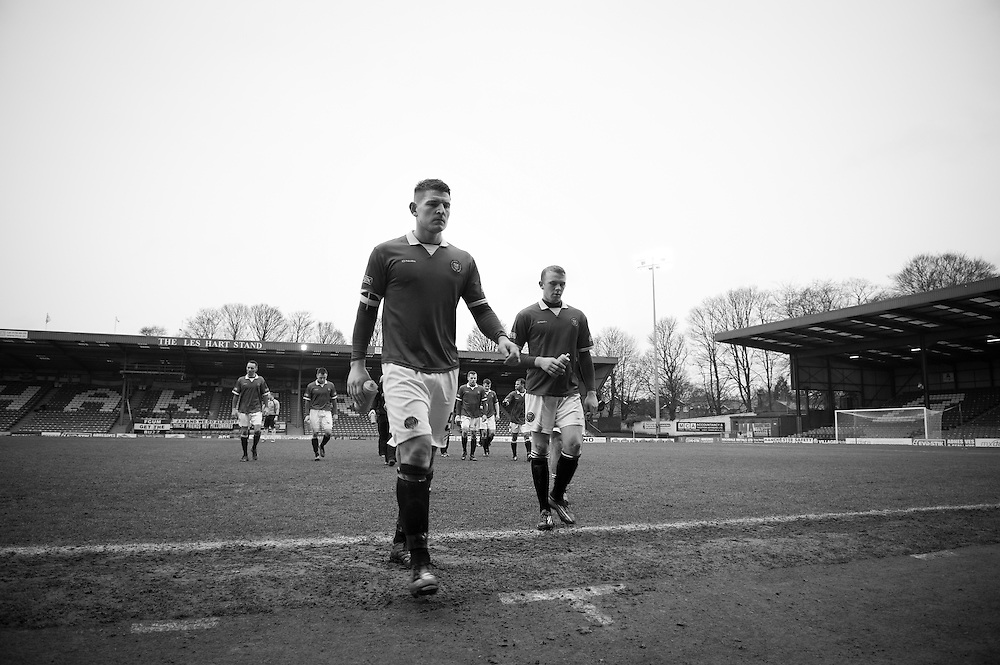 FC United of Manchester play a local team Chorley at Bury football club's ground in Lancashire, Britain. Photo shows FC United of Manchester player Adam Jones leaving the pitch after his team lost 3-1.