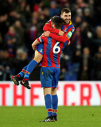 Crystal Palace's James McArthur (top) celebrates victory with Scott Dann at full time