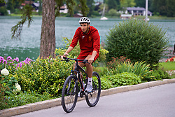 ROTTACH-EGERN, GERMANY - Thursday, July 27, 2017: Liverpool's Marko Grujic cycles back from training from the Seehotel Uberfahrt on the banks of Lake Tegernsee on day two of their preseason training camp in Germany. (Pic by David Rawcliffe/Propaganda)