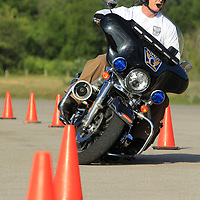 Sergeant Brett Moyer looks ahead as he keeps his eye on the course. The Tupelo motor unit also competes in the Mississippi Law Enforcement Association motor skills competition. They have been competing the 7 years. The training course benefits them in the competition.