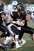 Erie Cathedral Prep Ramblers running back Matthew Lupo (21) runs for a 9 yard touchdown that ties the first quarter score at 14-14 during the 2017 high school football game against the against the Cleveland Benedictine Bengals, Friday, Sept. 15, 2017 in Erie, Pa. The Ramblers won the game 62-28. (©Paul Anthony Spinelli)