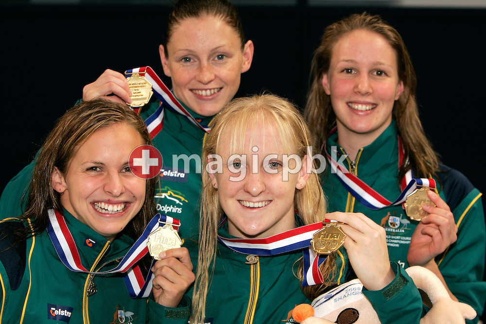 (L-R) Lisbeth LENTON , Shayne REESE, Jessicah SCHIPPER and Bronte BARRATT of Australia pose after the award ceremony of the women's 4x200 meter Freestyle relay final during day one of the 8th FINA World Swimming Championships (25m) held at Qi Zhong Stadium April 5, 2006 in Shanghai, China. Australia came from behind to win the gold medal. (Photo by Patrick B. Kraemer / MAGICPBK)