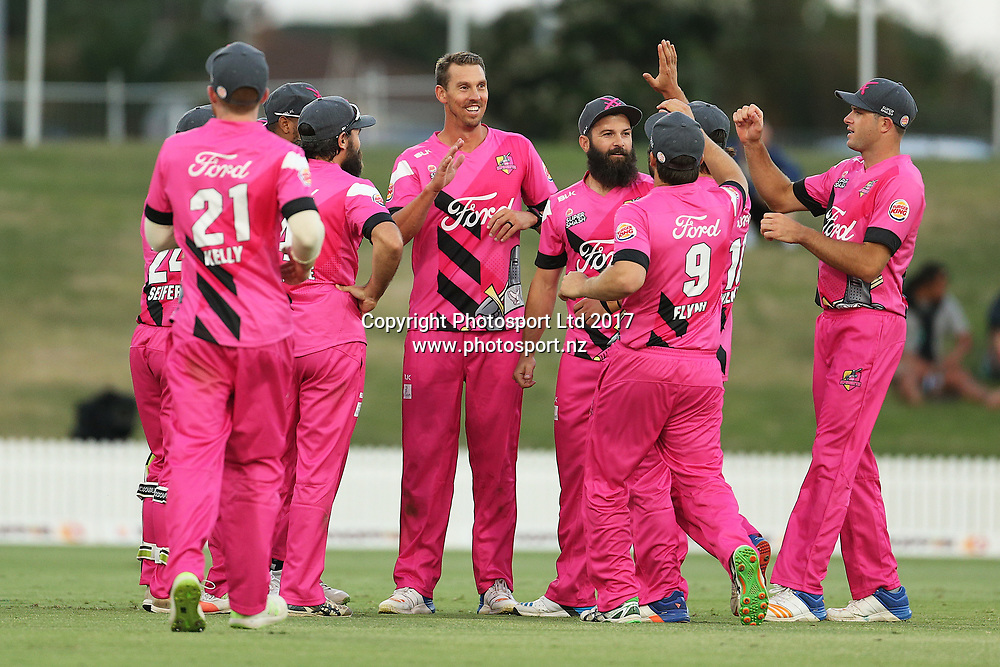 The Knights celebrate a wicket during the Burger King Super Smash Twenty20 cricket match Knights v Stags played at Bay Oval, Mount Maunganui, New Zealand on Wednesday 27 December 2017.<br /> <br /> Copyright photo: © Bruce Lim / www.photosport.nz