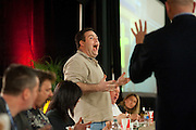 Bradley Hof stands up and shows the crowd that he has won his heat in the wing eating contest during ZestFest at the Irving Convention Center on Saturday, January 26, 2013 in Irving, Texas. (Cooper Neill/The Dallas Morning News)
