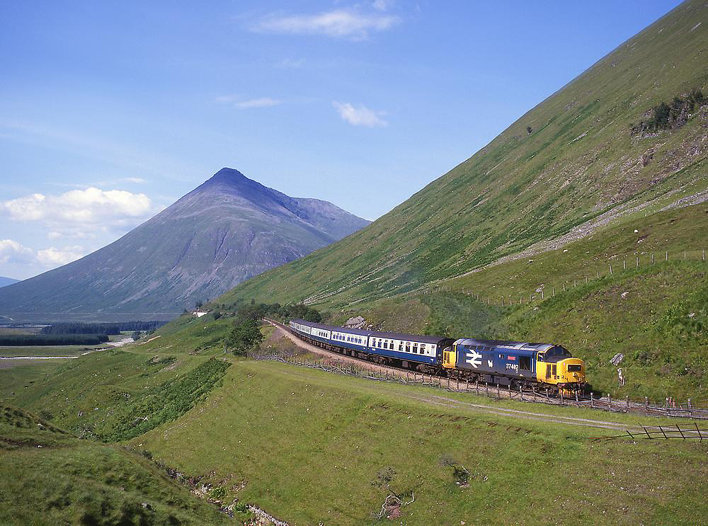 BR Class 37 diesel locomotive nearing tyndrum upper with ben dorain in view.West Highland line 1980's.