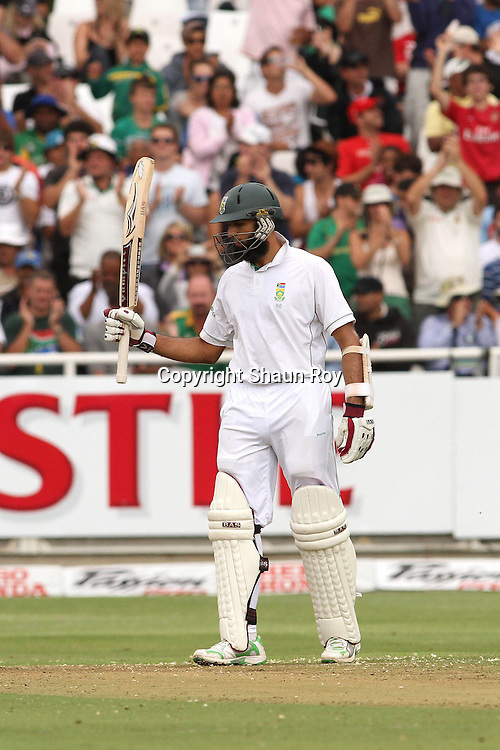 CAPE TOWN, SOUTH AFRICA - 2 January 2011, Hushim Amla of South Africa raises his bat after reaching his fifty during day 1 of the 3rd Castle Test between South Africa and India held at Sahara Park Newlands Stadium in Cape Town, South Africa on the 2 January 2011 .Photo by: Shaun Roy